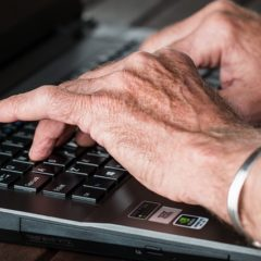 Old person using a laptop computer